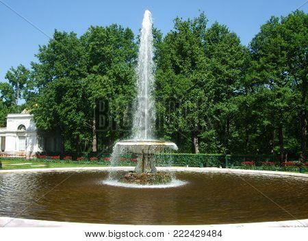 Petergof, Saint Peterburg, Russia - JUNE 12, 2013: A tall white fountain in a park in a Petergof