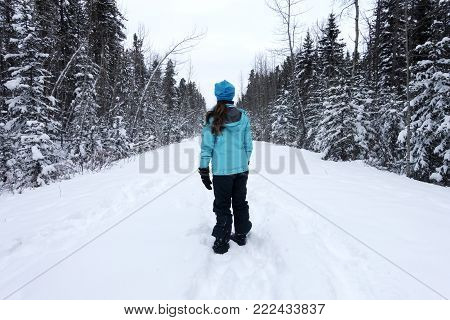Picture of a teenaged girl on a winter walk in Alberta,Canada.