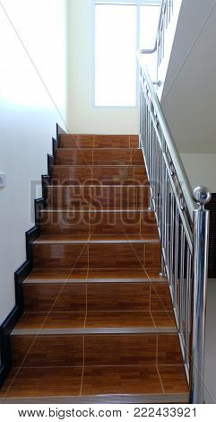 A stairs in a new home building with sunshine throught window,Beautiful stairs interior in new luxury home.View of stairs,