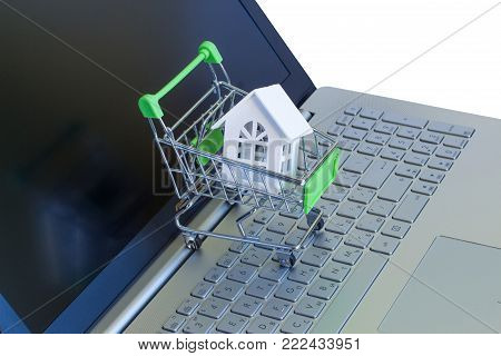 House in shopping cart on the computer. The concept of buying or selling real estate.