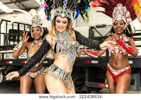 Brazilian woman dancing samba music at carnival party in an old factory