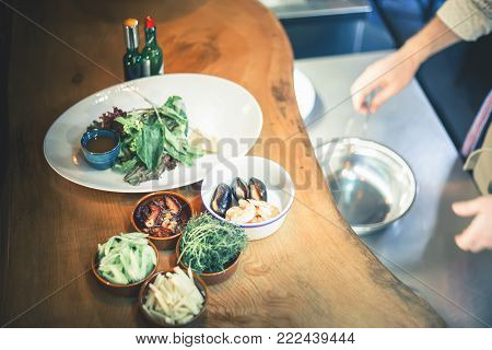 mussels seafood cooked in restaurant, frying. Cooking mussel with lemon. Cooking seafood meal, raw seafood with mussels, clams. Seafood shellfish salad
