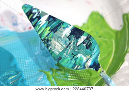 Macro photo of Palette Knife with acrylic paint
