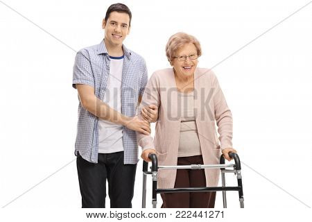 Young man holding a mature woman with a walker isolated on white background