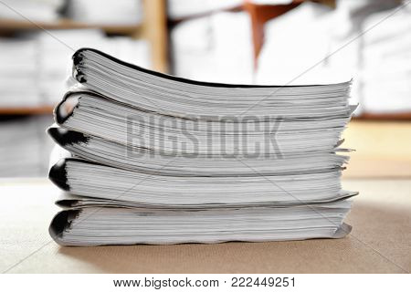 Stack of cardboard folders with documents in archive, closeup