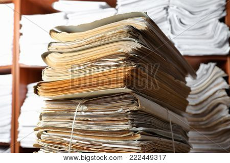 Stack of old documents in archive