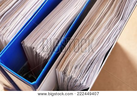 Folders with old paper documents in archive, closeup