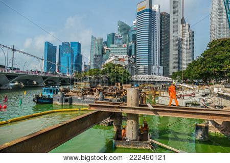 Singapore City, Singapore - 07 19 2015: View Of Building Construction Site Against Modern City In Singapore