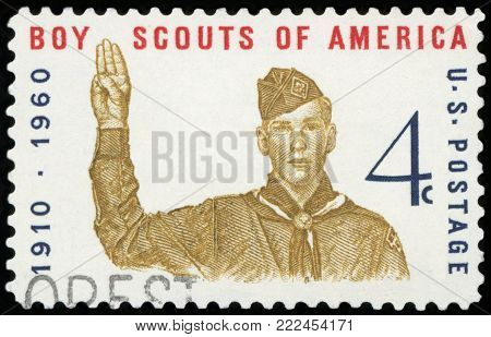 UNITED STATES OF AMERICA - CIRCA 1960: A stamp printed in USA shows Boy Scout Giving scout sign, with inscription