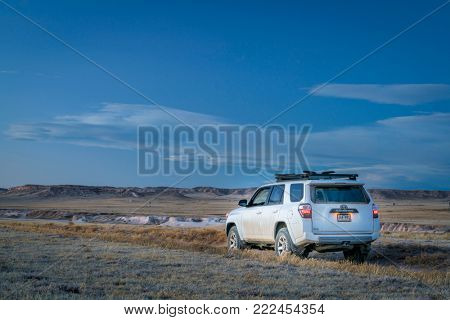 Nunn, CO, USA - January 9, 2018: Toyota 4Runner SUV (2016 Trail edition) on a dirt road in Pawnee National Grassland in northern Colorado.