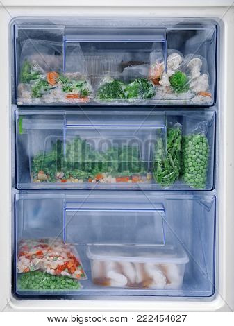 Different vegetables in refrigerator freezer