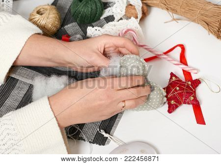 couple making decorations for Valentine's day, recover damaged heart, top view - romantic and love concept