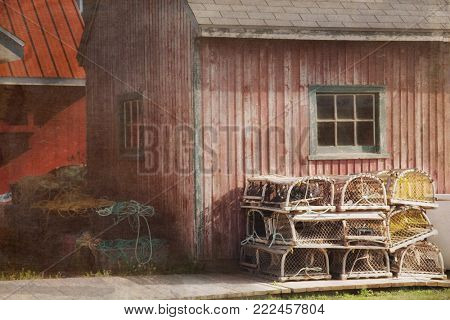 Lobster cages in front of an old oyster barn in PEI or Prince edward island in Canada with texture to looks used