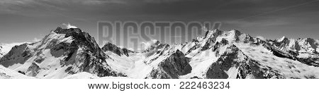 Panorama Of Snow Covered Mountains And Blue Sky At Sun Cold Day