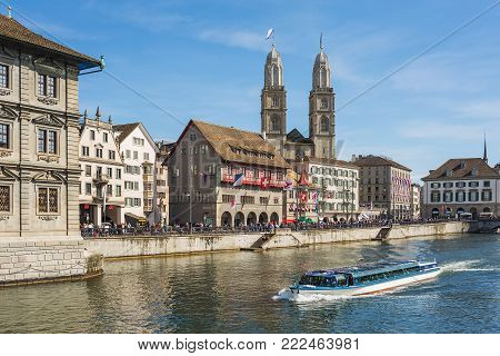 Zurich, Switzerland - 12 April, 2015: the Limmat river and buildings of the historic center of the city along it. Zurich is the largest city in Switzerland and the capital of the Swiss canton of Zurich.