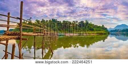 Beautiful view of a bamboo bridge. Luang Prabang. Laos landscape. Panorama