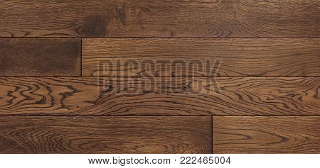 Wood texture of floor, oak parquet. Wood texture background for design, oak toned brown board .