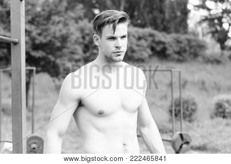 Athlete With Strong Torso And Muscles On Sports Ground