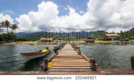Alotau in Papua New Guinea, South Pacific Islands, pontoon and boats with a nice blue sky with clouds