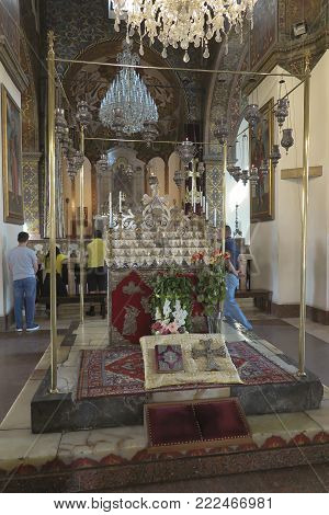 VAGHARSHAPAT, ARMENIA - SEPTEMBER 17, 2017: Inside one of the oldest  Etchmiadzin Cathedrals in the world. It has unique architectural style and design. Bible and reliquary