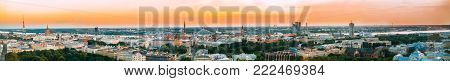 Riga, Latvia. Aerial View Panorama Cityscape At Sunset. TV Tower, Academy Of Sciences, St. Peter's Church, Boulevard Of Freedom, National Library, Dome Cathedral, Basilica Of St. James.