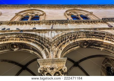 Closeup view at traditional stone architecture in city center of old town Dubrovnik, croatian travel resort and historical heritage site.
