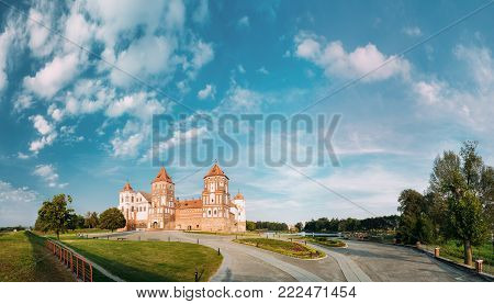 Mir, Belarus. Panorama Of Old Towers Of Mir Castle Complex On Blue Sunny Sunset Sky Background. Architectural Ensemble Of Feudalism, Cultural Monument, UNESCO Heritage. Famous Landmark In Summer poster