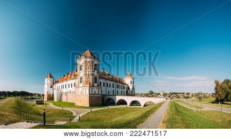 Mir, Belarus. View Of Old Towers Of Mir Castle Complex On Blue Sunny Sky Background. Architectural Ensemble Of Feudalism, Ancient Cultural Monument, UNESCO Heritage. Famous Landmark In Summer poster