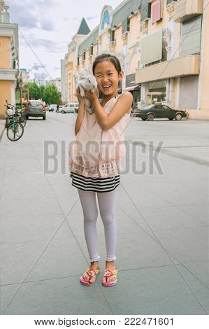 The Photo Of The Girl With The Rabbit On The Street...