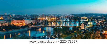 Panoramic view of cityscape of Prague, Czech Republic. In the right part of photo we can see the blue dome of the Straka Academy. The Straka Academy is the seat of the Government of the Czech Republic