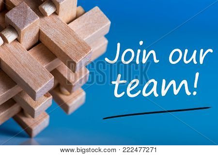 Join our team - message at blue background near macroviewed brain teaser. Hiring and new job concept.