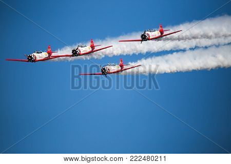 Stunt aircraft flying in formation against bright blue sky at air show performance | Air Show Owensboro, KY 2017