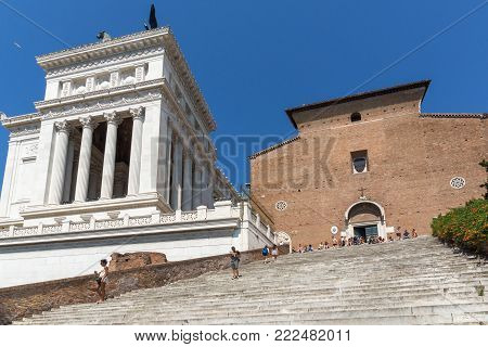 ROME, ITALY - JUNE 23, 2017: People in front of Chiesa di San Marcello al Corso in Rome, Italy