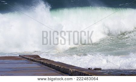 Enormous waves at the baths at Newcastle Beach, NSW, Australia
