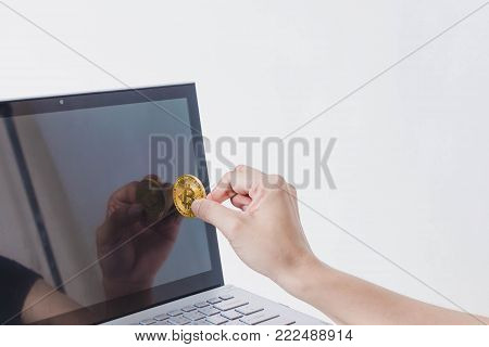 Bitcoin Paymant for Shopping Online in Notebook on White Background