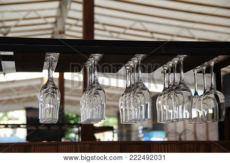 Crystal glasses upside down in the open air bar stock photo
