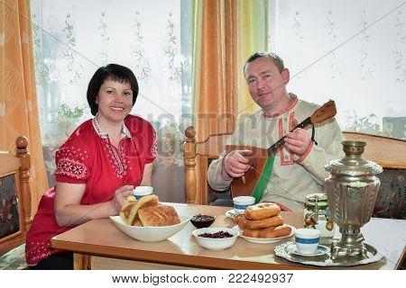 The Scene For The Morning Tea And Play The Balalaika
