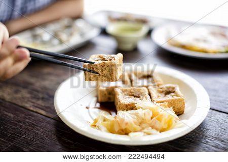 Taiwanese traditional food : Stinky tofu on table