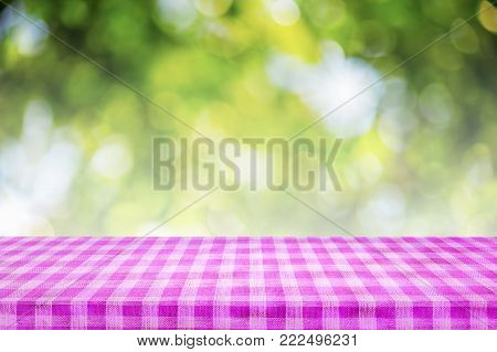 Checkered tablecloth texture top view on abstract green background. For display or montage your products.