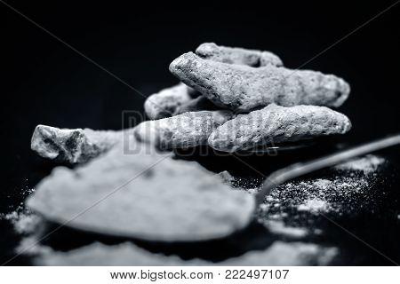Turmeric,curcuma Longa And Its Powder On A Wooden Surface.;