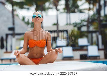 Elegant Sexy Woman In Bikini On Sun-tanned Slim And Shapely Body Posing Near Swimming Pool. Gorgeous