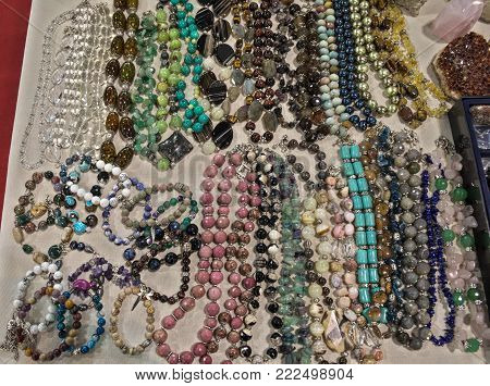 Bunch of cheap costume jewelry displayed on table