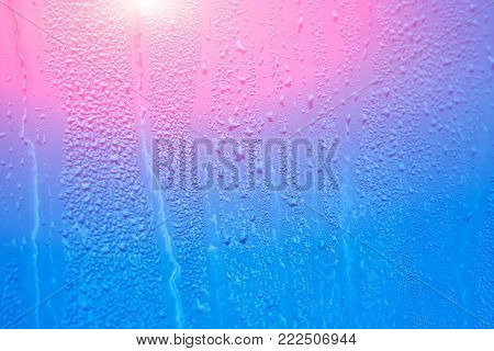 Wet window with condensation on the glass. Natural background with high humidity