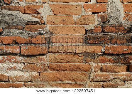 Stone brick Wall in the middle of clay, layered stack decoration, sunlight outdoor retro style, backgrounds, wallpaper
