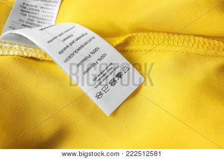 Clothing label with laundry instructions, closeup