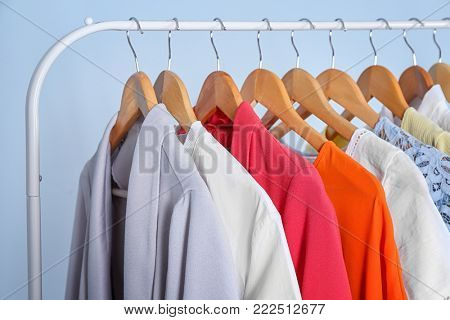 Clean clothes hanging on rack in laundry