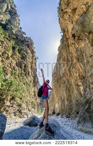 Happy hiker woman in Samaria gorge national park, Crete - Greece