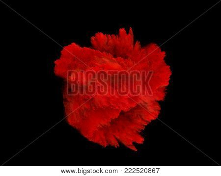 Explosion of red powder isolated on black background.