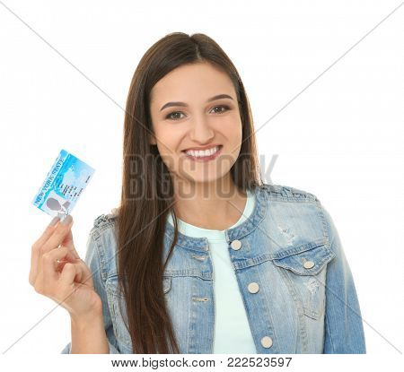 Young woman holding driving license on white background