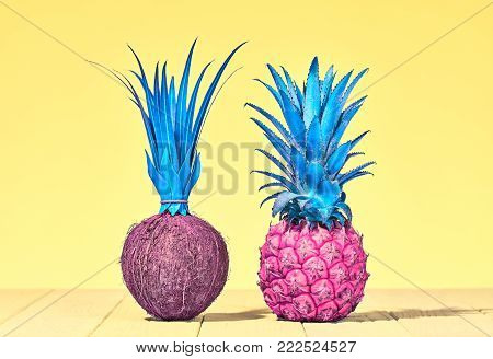 Tropical Pineapple and Coconut. Bright Summer Color. Creative Minimal. Hot Summer Vibes. Sunny Yellow background. Trendy fashion Style. Pop Art